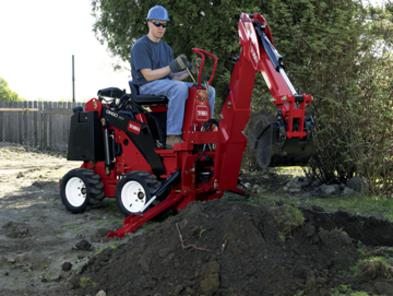 Toro Dingo TX 323 with backhoe attachment