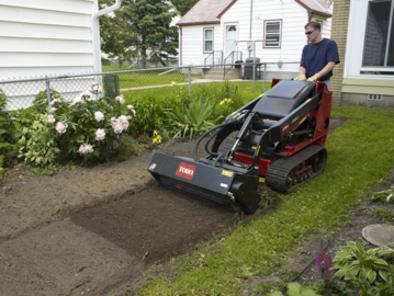 Toro Dingo TX 427 WIde Track with Tiller Attachment